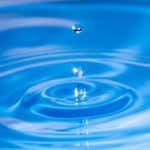 water drops on blue water