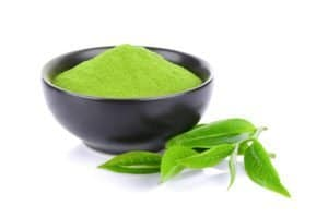 Green tea powder and leaf isolated